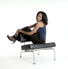smiling girl seated on a chair