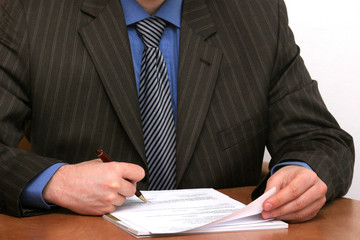 businessman is signing a document