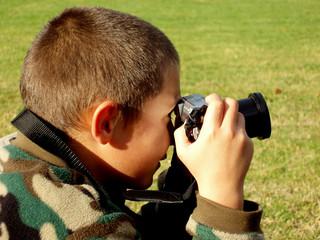 young boy on a photo job