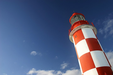 lighthouse under a deep blue sky