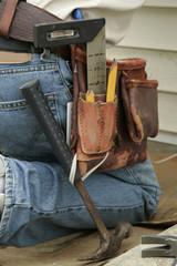 kneeling worker and tool belt