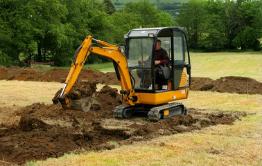 mini digger in action