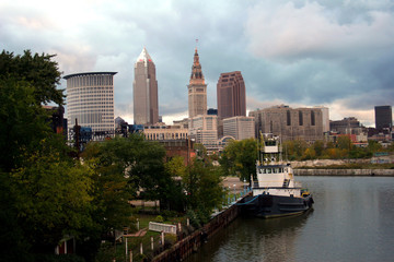 skyline of cleveland, ohio with boat on the cuyaho