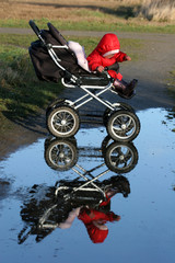 child in a carriage