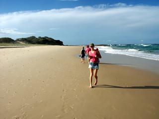 girl walking on beach 1
