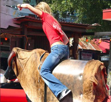 female mechanical bull rider