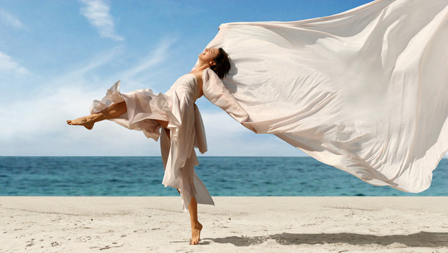 happy woman with a scarf on the beach