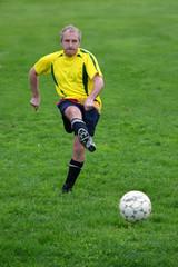 soccer player hitting a ball