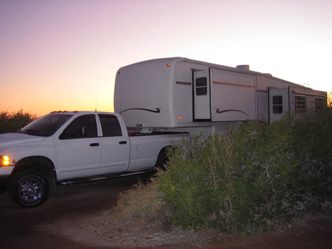 fifth wheel trailer at sunset