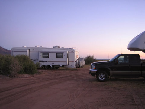 fifth wheel trailers at sunset