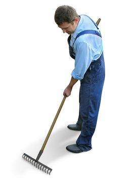 gardener  in working clothes, raking garden