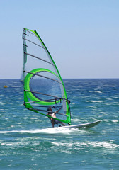 windsurfer on sunny tarifa beach in southern spain