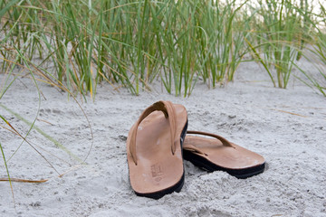 sandals at the shore