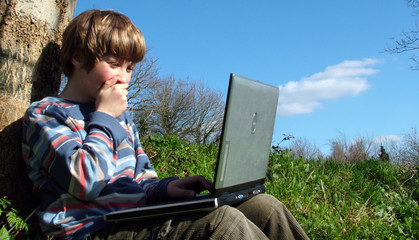 child with notebook sit blue sky 2