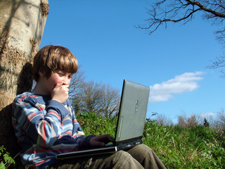 child with notebook sit blue sky 1
