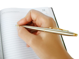 hand writing in a notebook with luxurious pen