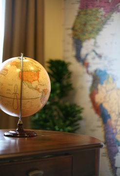 home office (focus on globe on desk)