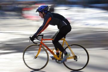 man racing on bicycle
