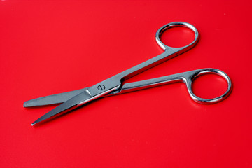 scissors on a red background
