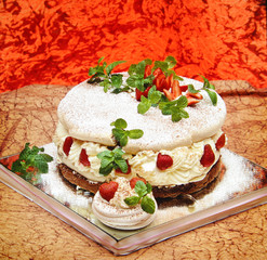 delicious cake with strawberry mint and cream