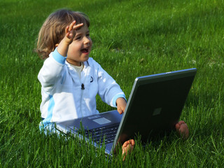 girl with computer on the grass
