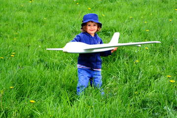girl with airplain on the grass