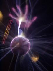 hand on plasma ball