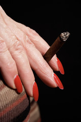 smoking a small cigar