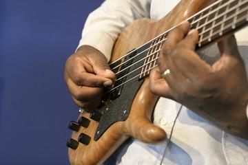 man playing guitar fingering