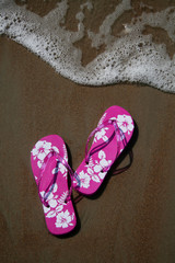 pink flip-flops on the sand