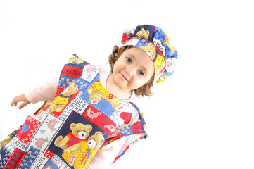 little girl  dressed as a cheff