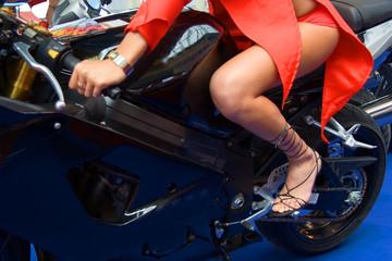 woman rides motorbike