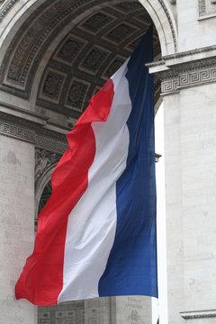 france flag on arc de triomphe paris