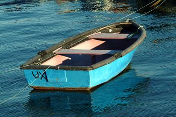 litle boat moored in port