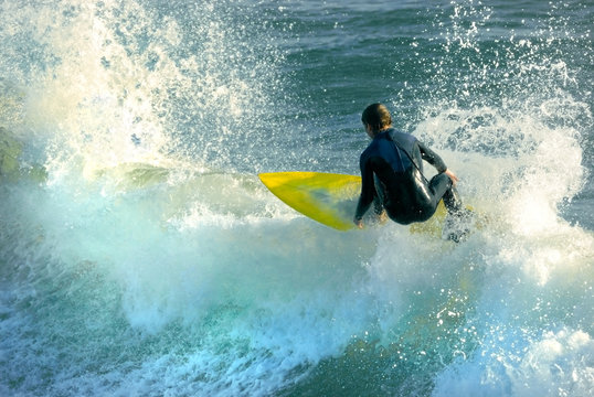 yellow surfboard, blue waters