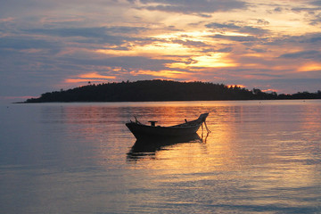 fishing boat in tropical sunrise