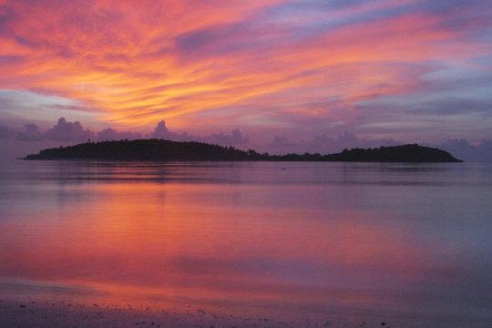 gorgeous sunrise over tropical island