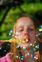 young girl soap bubbles