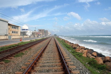 railway track, the blue sky and the blue sea