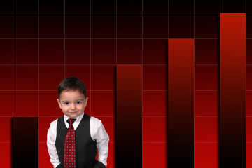 adorable toddler boy in suit standing against bar