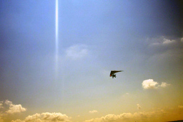 a hang-glider on a cloudy sky