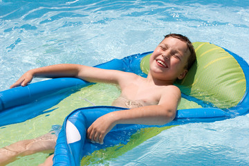 a boy having a fun in a pool