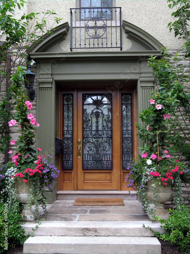 beautiful front door with flowers stock photo and royalty free