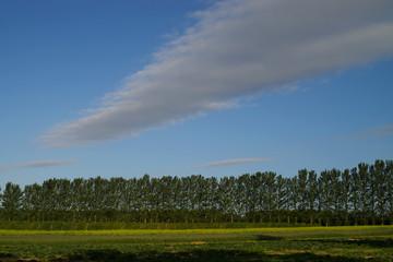 weird clouds over a farm field.