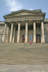 woman filming dancer on steps of liverpool museum