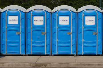 portable toilets with gereric signage