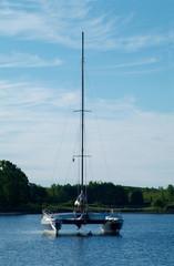 catamaran sailboat at anchor