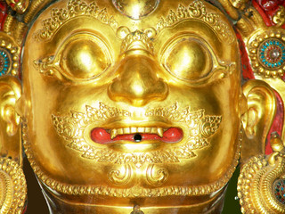 gold tibetan buddha head