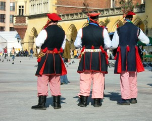 men in regional polish-cracow's suits