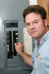 electrician at breaker panel